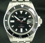 At 43 mm side to side (excl. crown), it's a little bigger than the usual Submariner