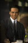 Vincent Piazza as Lucky Luciano. Tie pins were de rigeur of the day and if you notice the suit jacket button placement, the top button on a three button suit is chest level.