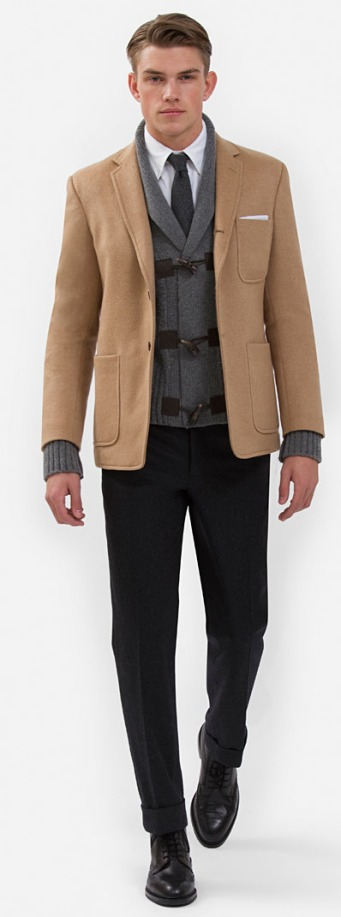Baby Camel Hair Patch Pocket Jacket: Double face camel hair. Three-button roll over lapel, with center back vent and patch pockets. Genuine horn buttons.