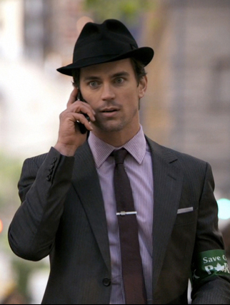 Gucci suit, Burberry shirt, Dior tie, Prada belt, vintage tie bar. - White Collar USA network