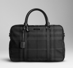 Charcoal check nylon travel bag with grainy leather trim with Top zip closure, two rolled grainy leather handles, webbed canvas detachable shoulder strap and Polished nickel plaque engraved with the Burberry logo