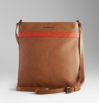 Leather messenger bag with leather handles and trim with Leather zip pull stamped with the Burberry logo