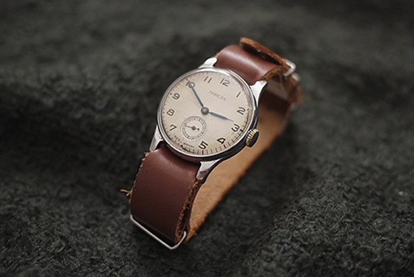 Commonly paired with 'tool' watches like divers and chronographs, the NATO strap can also be used with dress watches to achieve stylish contrast that engenders bystanders to take a second look.