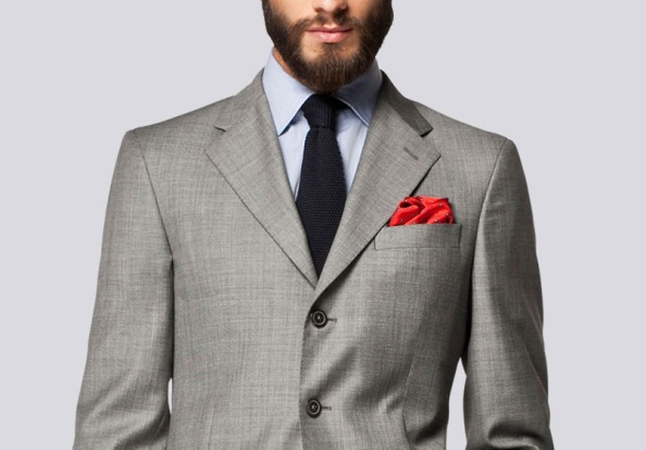 Although the details like pick stitching are incredibly subtle here, the subtlety of the accents as opposed to the navy blazer previously, sets the tone of dressing between serious debonair and playful. While it might be harder to wear the navy DB to a corporate office, this grey suit from Carolina Herrera fits in beautifully.
