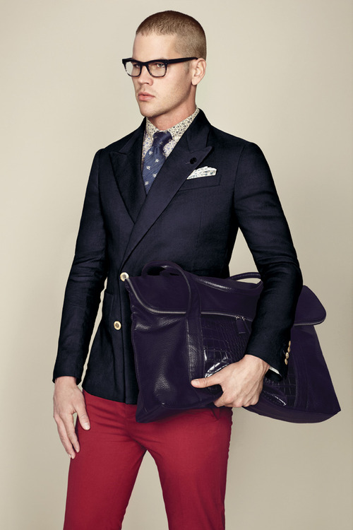 While the double breasted blazer is a weapon for sartorial formality, when paired with red trousers- it becomes dressed down. The navy patterned necktie lends the smart to smart casual. I wouldn't wear this to the office unless I worked in advertising or publishing.