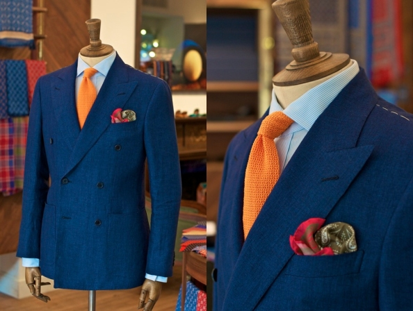 In this ensemble, the orange knit tie is matched with a complimentary red/green pocket square.