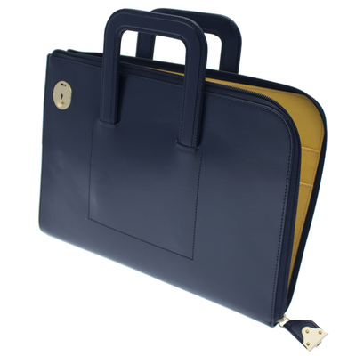 This navy leather zipped portfolio case which opens top and side is from Ettinger's Metropolitan Collection. The spacious internal compartment contains two pockets that hold A4 papers and four additional pockets perfect for smaller documents, smartphones, wallets and credit cards. The zip closes with a brass lock to guarantee complete security of contents. Two retractable handles means the Bakerloo portfolio may be carried as a case or under the arm.