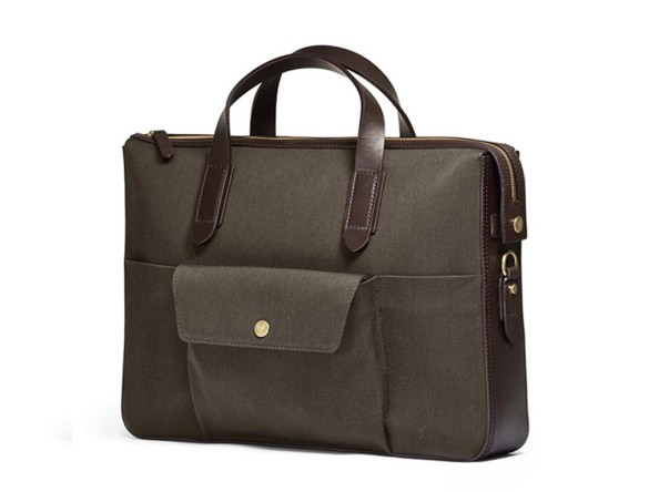 "The Mismo Pine Green briefcase is the natural choice for anyone dreaming of a handy yet stylish casual bag for the office. The bag features a separate inside laptop compartment (15""), and opposite two open ""slit down"" pockets. It has an outside signature pocket with enough room for an adaptor, etc. and two slim, slit-down pockets on either side for a mobile phone, iPod, pencils and more. Comes with an adjustable and detachable shoulder strap."