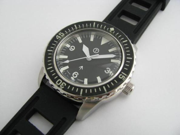 A military diving watch with sword hands rather than mercedes hands on a vintage Seamaster 300 homage.