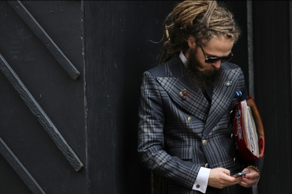 This man captured at London Men's Collection last June looks fantastic because even rocking a Double Breasted (with its extra material), he looks fitted. It helps that he has accessorised to the nines, from surprising dreadlocks to his buttonhole accessories, right down to the pattern and gold buttons he picked for his suit.