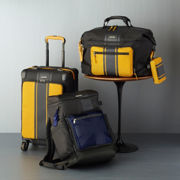 "It's a kind of intelligent design which makes this collaboration with Mini Cooper really cool yet functional. The yellow striped ""panels"" unzip to become their own laptop briefcase with the roll-on luggage, a tote bag with the backpack and another tote with the carry-all"