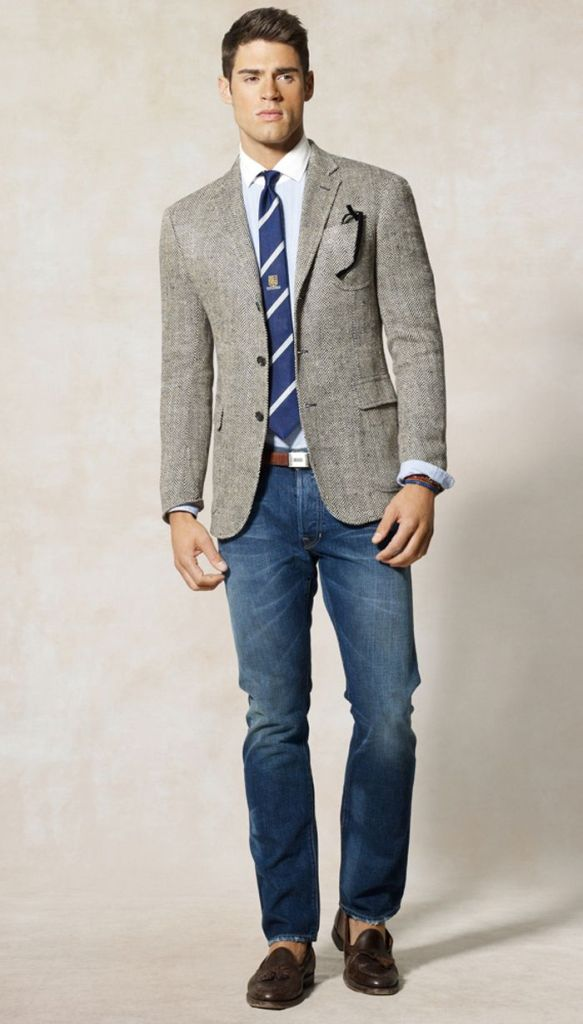 Your blazer and tie ensemble is dressed down with the strategic use of denim jeans and loafers worn sockless.
