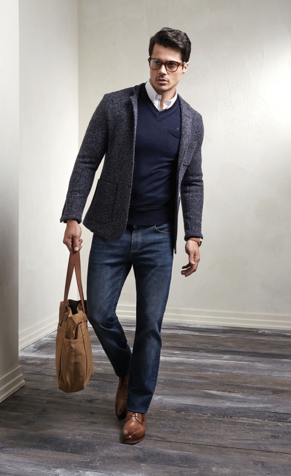 Eschew the tie but look professional with a different accessory: layered with a sweater and carrying a leather tote.